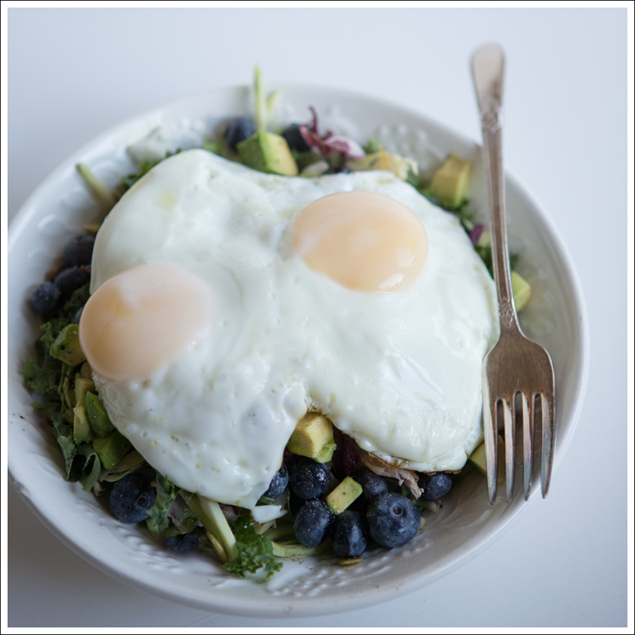 Blog Paleo Kale Broccoli Brussel Sprout Salad with Blueberries Avocado topped with a Fried Egg-1