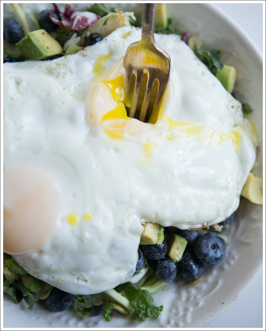 Blog Paleo Kale Broccoli Brussel Sprout Salad with Blueberries Avocado topped with a Fried Egg-2